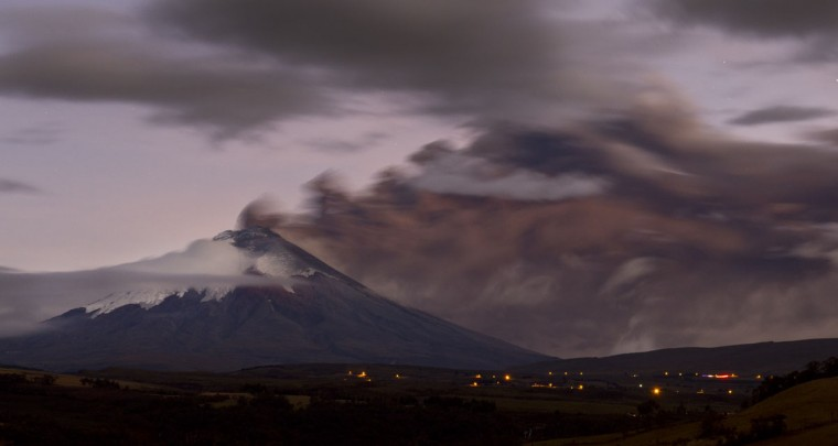 View from Sangolqui of the Cotopaxi volcano in Ecuador spewing ashes on August 23, 2015. Nearly 325,000 people could be affected by an eruption of Cotopaxi, the volcano looming beyond the Ecuadoran capital of Quito, officials said Monday. The biggest risk is from an eruption melting the mountain's snowcap and triggering massive melt-water floods and lahar mudflows that could sweep through nearby towns, Ecuador's minister of risk management Maria del Pilar Cornejo told a press conference. (MARTIN BERNETTI/AFP/Getty Images)