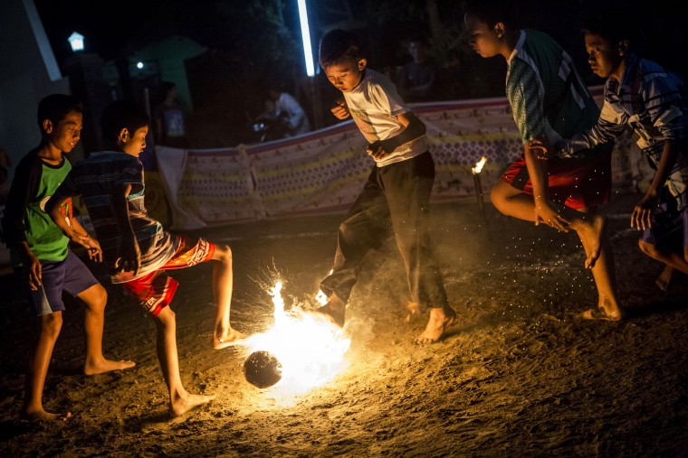 Children play a game of fire football, known as 'bola api', a coconut is soaked in kerosene and set on fire during celebrations of Indonesia's National Independence Day on August 15, 2015 in Yogyakarta, Indonesia. Indonesia became an independent nation on August 17, 1945 having previously been under Dutch rule. (Ulet Ifansasti/Getty Images)