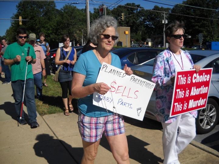 Katie Schmitz, 56, of Phoenix (left) and Regina Meyers, 59, of Harford County, were among protesters Saturday at the Planned Parenthood center in Towson during nationwide demonstrations against the organization. (Jessica Anderson/Baltimore Sun)