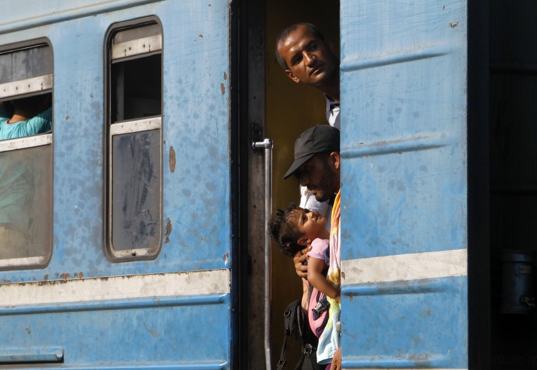 Migrants wait to depart aboard a train heading towards Serbia, at the railway station in the southern Macedonian town of Gevgelija, Saturday, Aug. 15, 2015. Macedonia is a major transit route for thousands of migrants from Middle East, Asia and Africa who are heading north through the Balkans on their way to the more prosperous European Union countries. (Boris Grdanoski/Associated Press)
