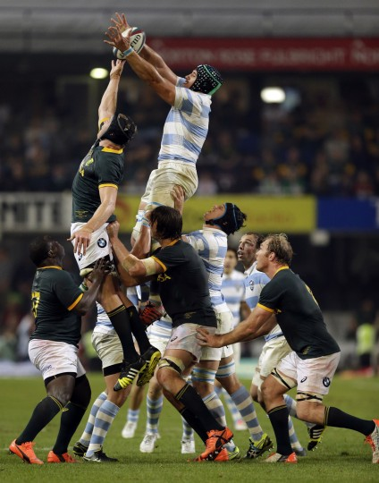 South Africa's Pieter-Steph du Toit, top left, and Argentina's Tomas Lavanini, top right, miss catche the ball during the line out for their Rugby Championship match at Kings Park stadium in Durban, South Africa, Saturday, Aug. 8, 2015. Argentina beat South Africa 37-25. (Themba Hadebe/Associated Press)