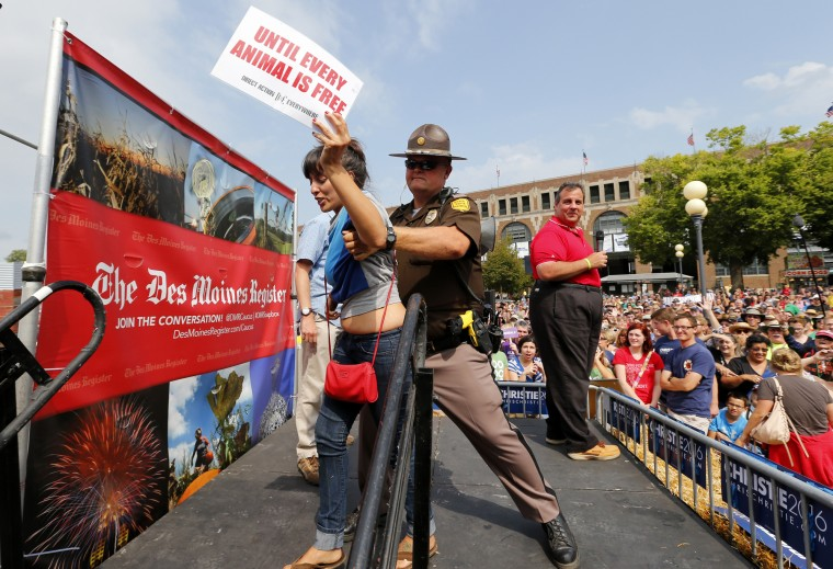 An Iowa State Trooper removes a protester from the stage as Republican presidential candidate, New Jersey Gov. Chris Christie speaks at the Iowa State Fair Saturday, Aug. 22, 2015, in Des Moines, Iowa. (Paul Sancya/Associated Press)