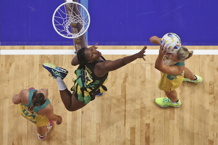 Australia's Catlin Bassett, right, shoots for goal as Jamaica's Stacian Facey jumps for a defense during their Netball World Cup semifinal match in Sydney Saturday, Aug. 15, 2015. (Rob Griffith/Associated Press)