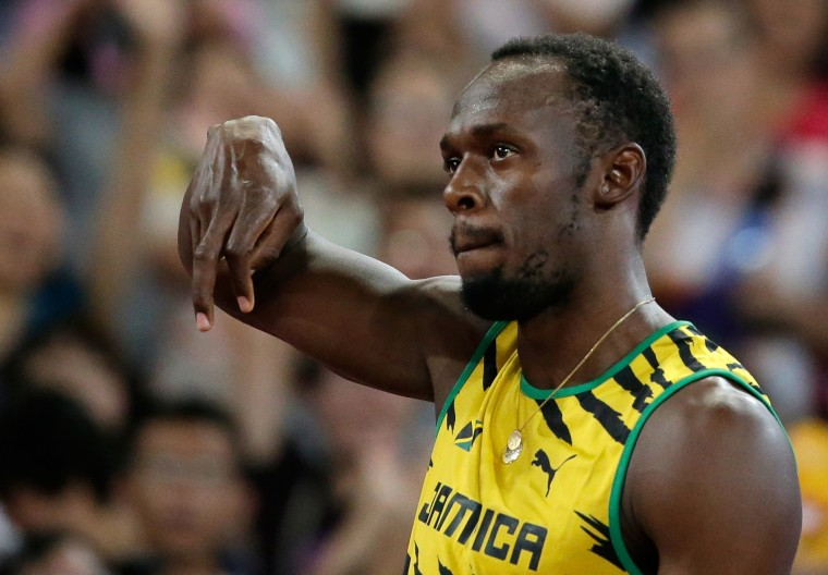 Jamaica's Usain Bolt gestures before starting round one of the men's 100m at the World Athletics Championships at the Bird's Nest stadium in Beijing, Saturday, Aug. 22, 2015 (Andy Wong/Associated Press)