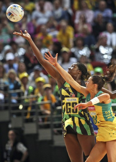 Australia's Sharni Layton, right, and Jamaica's Jhaniele Fowler-Reid wait for the ball during their Netball World Cup semi final in Sydney, Australia, Saturday, Aug. 15, 2015. (Rob Griffith/Associated Press)