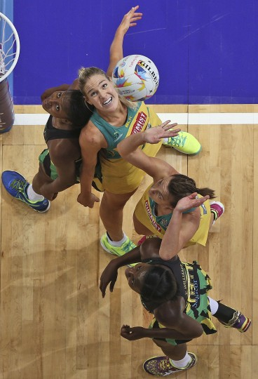 Australia's Catlin Bassett, top right, and Natalie Medhurst, center right, fight for the ball with Jamaica's Stacian Facey, top left, and Romelda Aiken during their Netball World Cup semifinal match in Sydney Saturday, Aug. 15, 2015. (Rob Griffith/Associated Press)