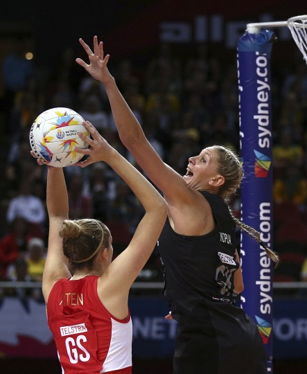 New Zealand's Casey Kopua, right, leaps to block a shot from England's Joanne Harten during their Netball World Cup semifinals in Sydney, Australia, Saturday, Aug. 15, 2015. (Rob Griffith/Associated Press)