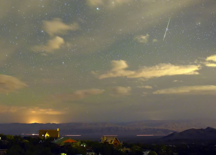 A Perseid meteor streaks across the sky over the community of Cold Creek on August 12, 2015 in the Spring Mountains National Recreation Area, Nevada. The annual display, known as the Perseid shower because the meteors appear to radiate from the constellation Perseus in the northeastern sky, is a result of Earth's orbit passing through debris from the comet Swift-Tuttle. (Photo by Ethan Miller/Getty Images)