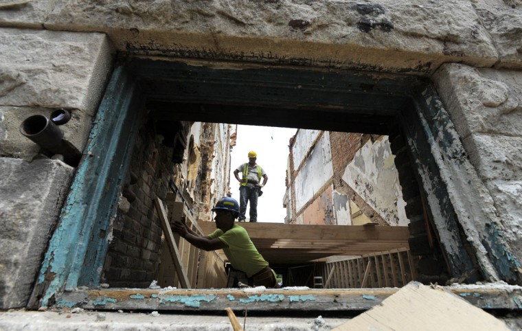Homes in the 2300 block of Callow Ave. are being renovated on July 15, 2015. Tour of Reservoir Hill and the projects that are underway there. (Lloyd Fox/Baltimore Sun)
