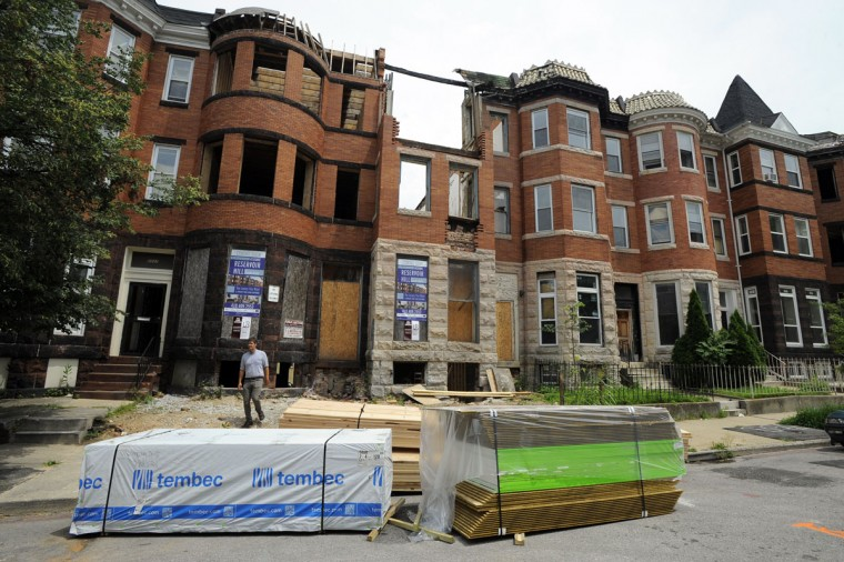 Eli Lopatin of the Reservoir Hill Improvement Council is pictured in the 2300 block of Callow Ave., where homes are being renovated. Tour of Reservoir Hill and the projects that are underway there. (Lloyd Fox / Baltimore Sun / July 15, 2015