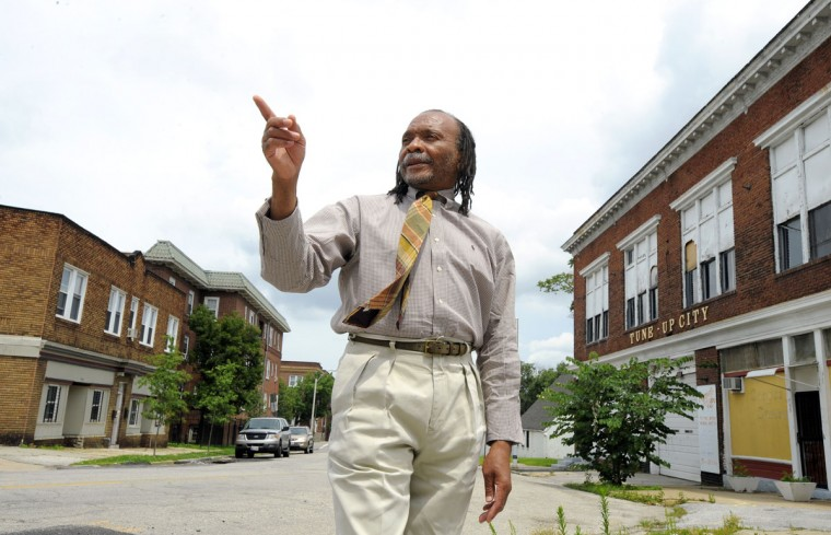 Carl Cleary of the Reservoir Hill Improvement Council stands on Whitelock Ave., on July 15, 2015. The tour of Reservoir Hill and the projects that are underway there are showcased (Lloyd Fox/Baltimore Sun)