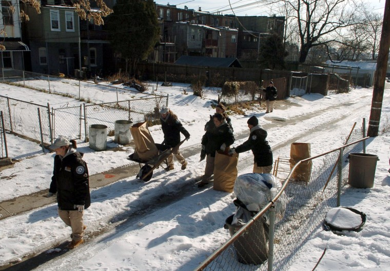 AmeriCorps and National Civilian Community Corps (NCCC) Members clean an alley off of Whitelock St. in the Oliver and Reservoir Hill communities on Feb. 1, 2005. (Baltimore Sun photo by Lloyd Fox)