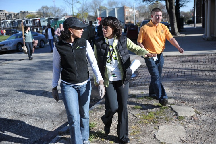 From left, Mayor Sheila Dixon and Hope M. Williams, Initiative For A Cleaner Greener Baltimore, walk toward a tree which they will ceremonially plant in Reservoir Hill. The mayor visited the neighborhood on April 19, 2009 to kick off the annual Spring Clean-Up. (Kim Hairston / Baltimore Sun)