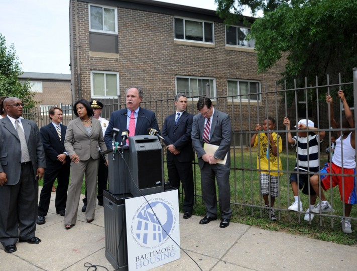 Baltimore City Housing Commissioner Paul T. Graziano (at podium), along with Mayor Stephanie Rawlings-Blake and other officials announce the city's plans for the Madison Park North Apartments complex on Aug. 17, 2010. (Barbara Haddock Taylor / Baltimore Sun)