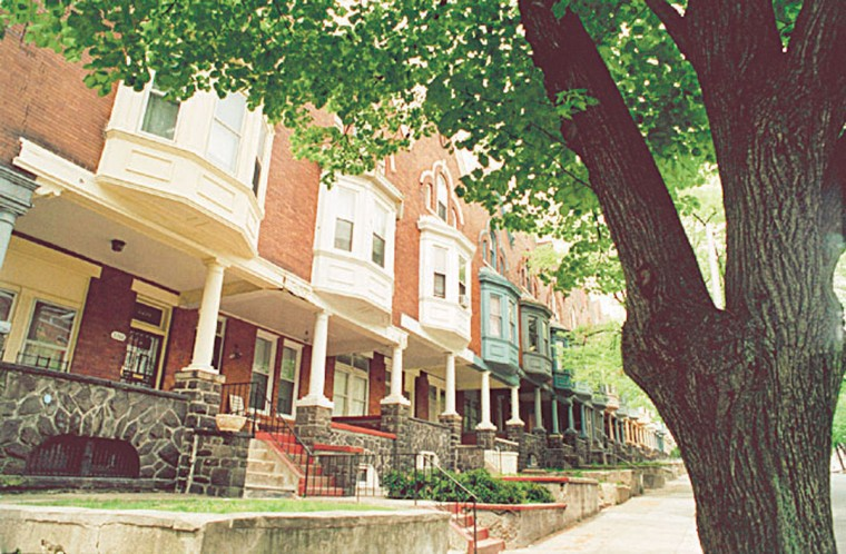 The Reservoir Hill neighborhood has an incredible amount of architecturally distinguished houses dating from the late 19th century. This is Linden St. near the intersection of Ducatel on April 25, 2001. (Photo by Algerina Perna/Baltimore Sun)