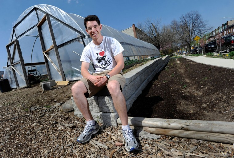 Teddy Krolik, environmental and sanitation program director for Reservoir Hill Improvement Council, sits near Whitelock Community Farm on April 11, 2013. The farm is among the neighborhood projects that Krolik and Reservoir Hill Improvement Council have supported. (Photo by Steve Ruark / Special to The Baltimore Sun)
