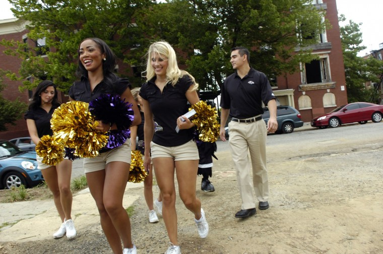 More than 300 volunteers from the Baltimore Ravens, the Reservoir Hill Improvement Center and Baltimore Housing, oganizers from KaBOOM! and residents of the local community joined together June 16, 2011 to build a brand new playground in just one day. (Gabe Dinsmoor / Baltimore Sun)