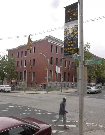 "Two century-old buildings at 1100 Whitelock St., at the corner of Madison Ave., are being rehabbed by A.A.D. Developer, Inc., into 9 luxury apartment units. This is one of several reconstruction projects underway in Reservoir Hill, which may be seeing a turnaround, as evidenced by the new Reservoir Hill Improvement Council banners which proclaim, ""Blooming With Opportunity."" (Baltimore Sun photo by Amy Davis / May 28, 2004)"