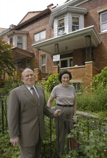 Rabbi Jon Konheim and his wife Rena are pictured outside their new Reservoir Hill home on Brooks Lane on May 28, 2004. Their 102-year-old house, divided into two apartments, was vacant for three years before they bought it in March. After being totally gutted, it will be restored as a single family home again. Rabbi Konheim's synagogue, Temple Beth Am, is a few blocks away in the Reservoir Hill neighborhood. (Baltimore Sun photo by Amy Davis)