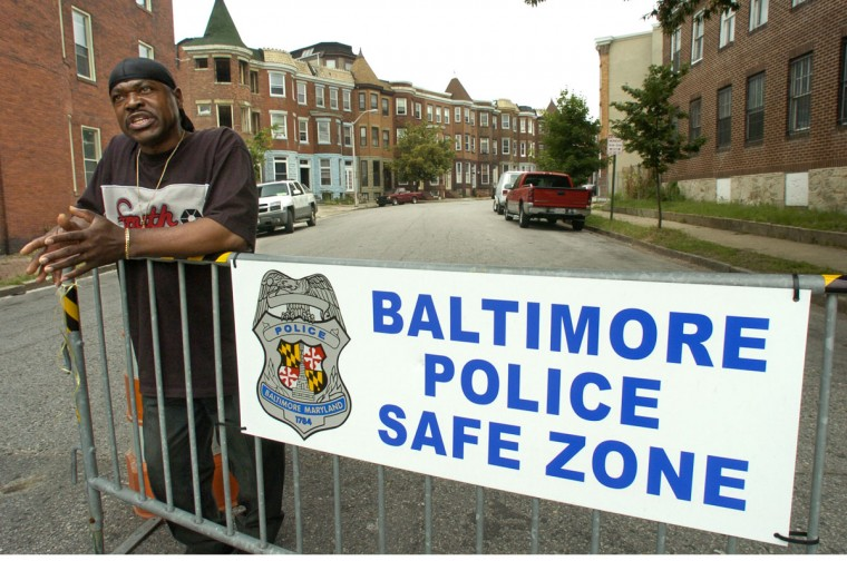 "Curt Brown, 54, a resident of Reservoir Hill since 1974, spoke aboout the ""Baltimore Police Safe Zone"" movable barricades, as he waited for a bus on Park Avenue on June 14, 2006. He thought the presence of a police car had a greater impact than the barricades themselves. (Baltimore Sun photo by Amy Davis)"