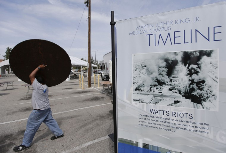 A worker sets up for the inauguration of the new Martin Luther King Jr. Community Hospital on Thursday, Aug. 6, 2015 in the Watts area of Los Angeles. The Watts riots broke out Aug. 11, 1965, almost 50 years ago and raged for most of a week. (AP Photo/Chris Carlson)