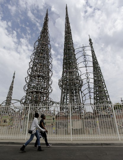Visitors walk past the Watts towers on Thursday, Aug. 6, 2015 in the Watts area of Los Angeles. The Watts riots broke out Aug. 11, 1965, almost 50 years ago and raged for most of a week. (AP Photo/Chris Carlson)