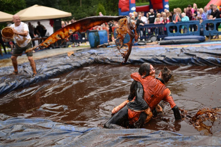 Gary is added to the pit as competitors take part in the 8th annual World Gravy Wrestling Championships at the Rose n Bowl Pub in Bacup, north west England on August 31, 2015. (OLI SCARFF/AFP/Getty Images)
