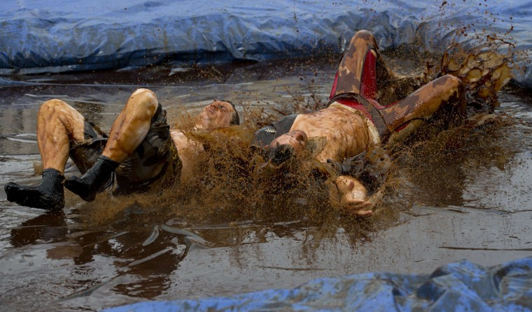 Competitors take part in the 8th annual World Gravy Wrestling Championships at the Rose n Bowl Pub in Bacup, north west England on August 31, 2015. (OLI SCARFF/AFP/Getty Images)