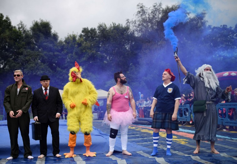 Competitors line up before taking part in the 8th annual World Gravy Wrestling Championships at the Rose n Bowl Pub in Bacup, north west England on August 31, 2015. (OLI SCARFF/AFP/Getty Images)