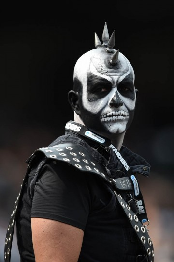 A fan looks on from the stands during the first half of the NFL game between the Oakland Raiders and the Cincinnati Bengals at O.co Coliseum on September 13, 2015 in Oakland, California. (Thearon W. Henderson/Getty Images)