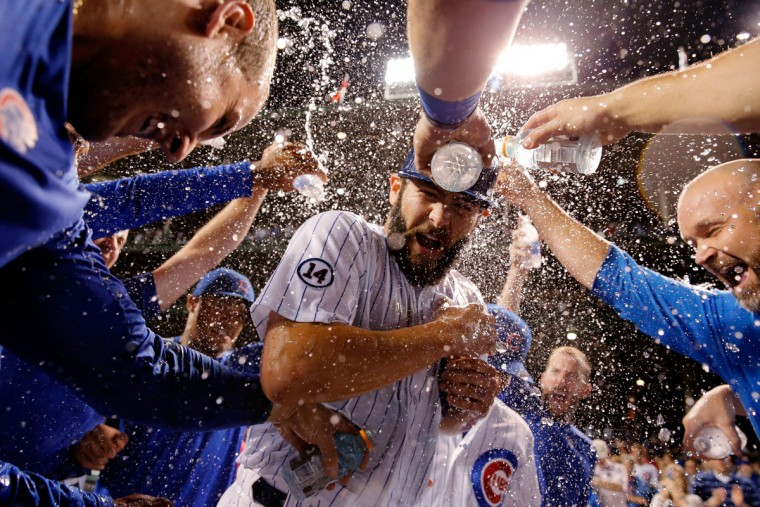 The Chicago Cubs celebrate with Jake Arrieta #49 on his 20th win of the season against the Milwaukee Brewers at Wrigley Field on September 22, 2015 in Chicago, Illinois. The Chicago Cubs won 4-0. (Photo by Jon Durr/Getty Images)