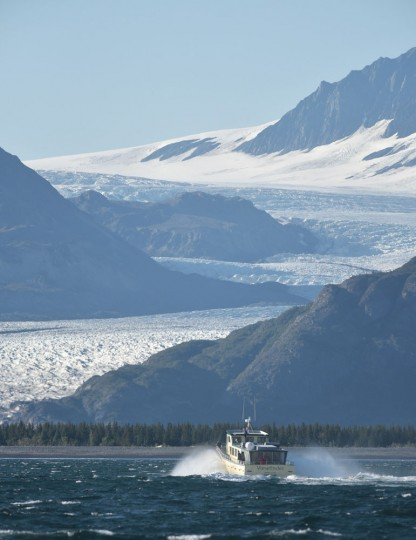 "The ""Viewfinder"" carrying US President Barack Obama approaches Bear Glacier during a tour of the Kenai Fjords National Park on September 1, 2015 in Seward, Alaska. Bear Glacier is the largest glacier in Kenai Fjords National Park. (Mandel Ngan/AFP/Getty Images)"