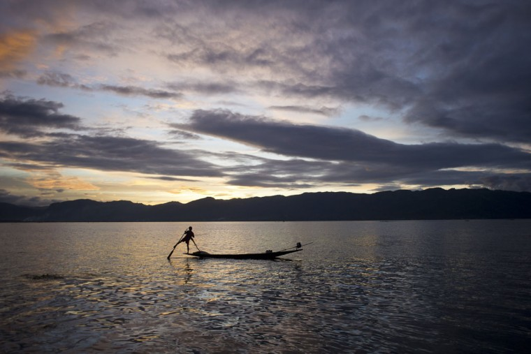 This photo, taken on September 7, 2015, shows a traditional fisherman riding a small boat on Inle Lake in Myanmars northeastern Shan state. (AFP Photo/Ye Thuye aung thu)