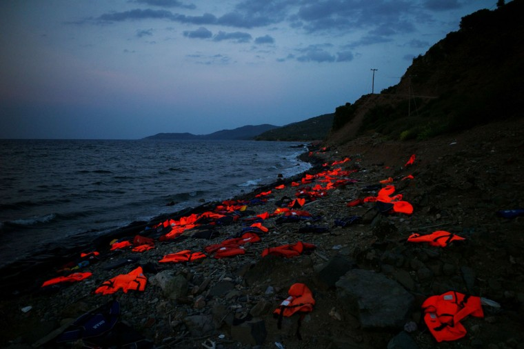 This photo taken on September 8, 2015 on the Greek island of Lesbos shows life vests left on the shore by incoming refugees. Overwhelmed by the 20,000 refugees and migrants currently camped on the holiday island, authorities hastily set up a refugee registration centre September 8 on a parched old football pitch. Local authorities have found it impossible to keep up with the pace of the influx, and tensions have boiled over. (AFP Photo/Angelos Tzortzinis)