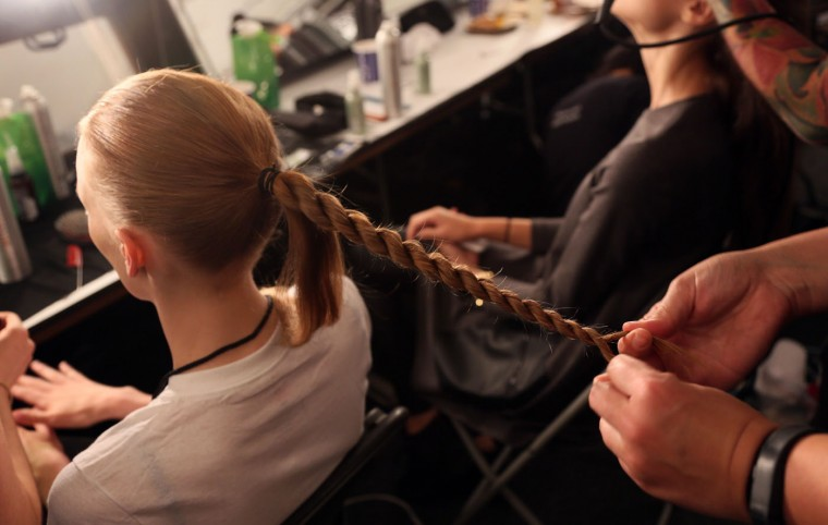 A model has her hair styled backstage before the Public School presentation during New York Fashion Week in New York on September 13, 2015. (Trevor Collens/AFP/Getty Images)
