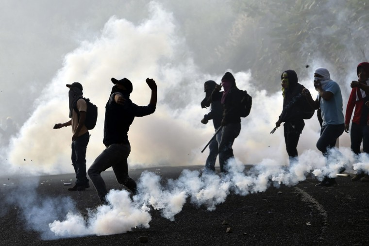 Student teachers from Ayotzinapa angry for the disappearance of 43 students clash with the riot police along the Tixtla-Chilpancingo highway in Tixtla, Guerrero State, Mexico, on September 22, 2015. (YURI CORTEZ/AFP/Getty Images)