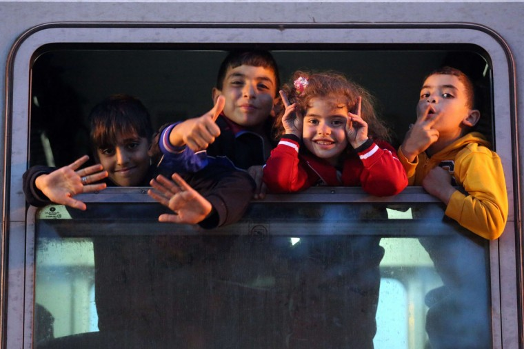 Migrant children gesture in a train heading to the Croatian-Hungarian border, at the train station of the east-Croatian town Tovarnik on September 22, 2015. More than 300,000 migrants have arrived by sea in Greece since January, the majority of whom continue their journey through Macedonia and Serbia on their way to EU countries Hungary and Croatia. (AFP Photo/Stringerstr/afp/getty Images )