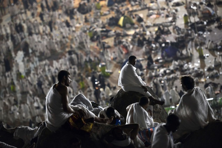 Muslim pilgrims join one of the Hajj rituals on Mount Arafat near Mecca early on September 23, 2015. Arafat Day, on the 9th of the Islamic month of Dhul Hijja, is the climax of the hajj season. Pilgrims gather on the hill known as Mount Arafat, and its surrounding plain, where they remain until evening for prayer and Koran recitals. Prophet Mohammed is believed to have delivered his final hajj sermon there. (AFP Photo/Mohammed Al-Shaikh)