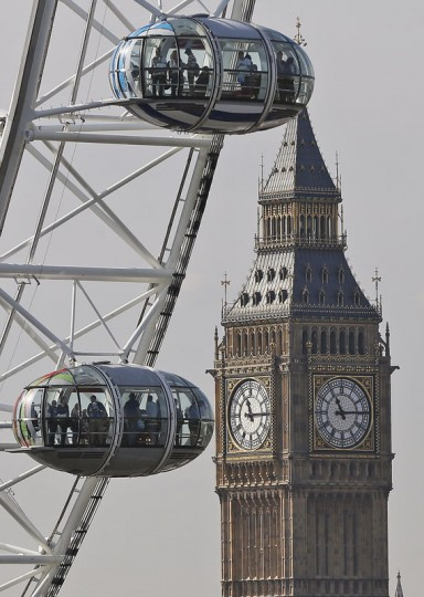People on the London Eye look at London landmark Big Ben during a a bright September morning in London, Friday, Sept. 11, 2015.(AP Photo/Frank Augstein)