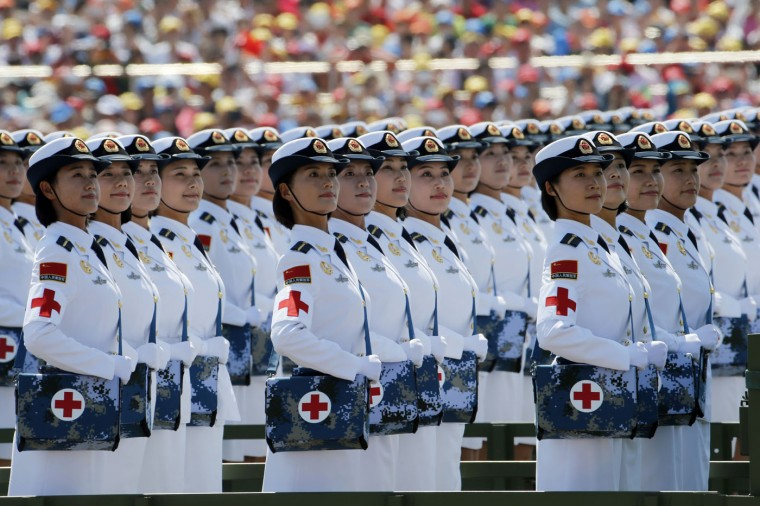 Chinese military medics take part in a parade commemorating the 70th anniversary of Japan's surrender during World War II held in front of Tiananmen Gate in Beijing, Thursday, Sept. 3, 2015. The spectacle involved more than 12,000 troops, 500 pieces of military hardware and 200 aircraft of various types, representing what military officials say is the Chinese military's most cutting-edge technology. (AP Photo/Ng Han Guan)