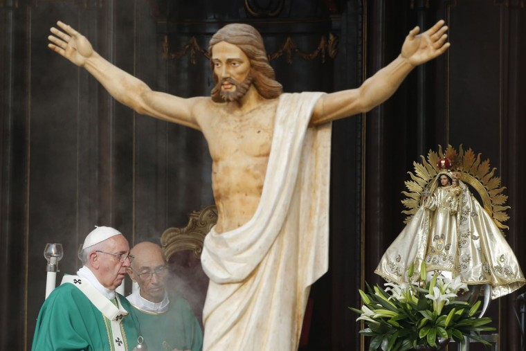 Statues of Jesus and the Virgin of Charity, also known as Our Lady of El Cobre, decorate the altar where Pope Francis celebrates Mass at Revolution Plaza in Havana, Cuba, Sunday, Sept. 20, 2015. Pope Francis opens his first full day in Cuba on Sunday with what normally would be the culminating highlight of a papal visit: Mass before hundreds of thousands of people in Havana's Revolution Plaza. (AP Photo/Desmond Boylan)