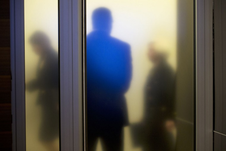 Federal Reserve Chair Janet Yellen, right, walks past a frosted glass door as she arrives to speak at a news conference in Washington, on Thursday, Sept. 17, 2015. The Federal Reserve is keeping U.S. interest rates at record lows in the face of threats from a weak global economy, persistently low inflation, and unstable financial markets. (AP Photo/Jacquelyn Martin)