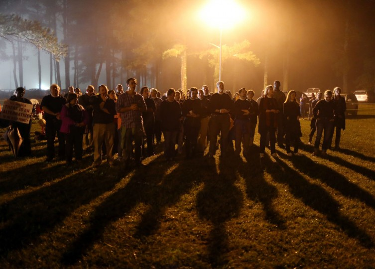 Protesters sing outside of Georgia Diagnostic Prison in Jackson, Ga., Tuesday, Sept. 29, 2015, before the scheduled execution of Kelly Renee Gissendaner. Gissendaner, who was scheduled to die by lethal injection Tuesday, was convicted of murder in the February 1997 slaying of her husband. (Ben Gray/Atlanta Journal-Constitution via AP)