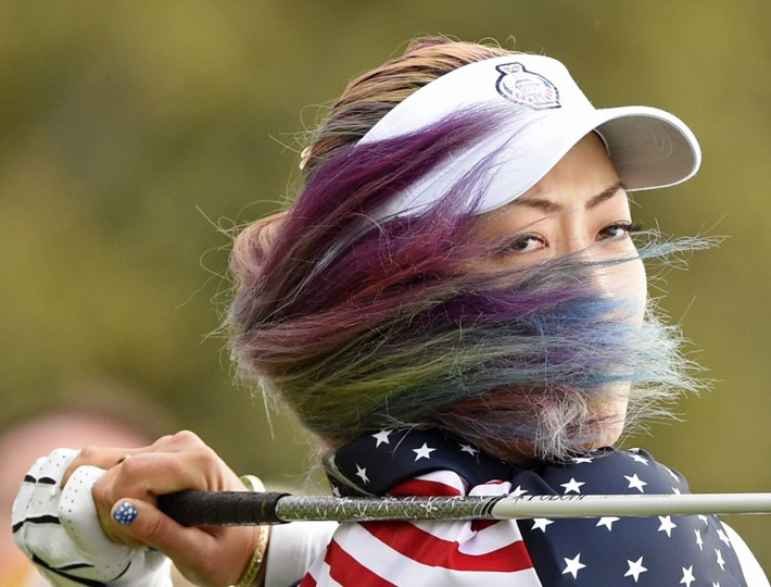 United States' Michelle Wie hits a ball in the singles on Day3 at the Solheim Cup golf tournament in St. Leon-Rot, southern Germany, Sunday, Sept. 20, 2015. (AP Photo/Jens Meyer)