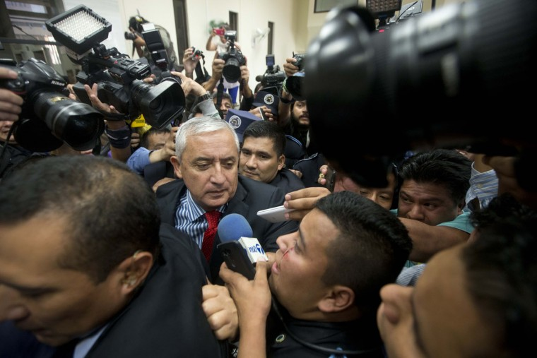 Guatemala's President Otto Perez Molina arrives to court to face corruption charges, after submitting his resignation in Guatemala City, Thursday, Sept. 3, 2015. The president submitted his resignation at midnight local time late Wednesday after a judge issued an order to detain him in a corruption scandal. Perez Molina was already under order not to leave the country, and on Tuesday the congress lifted his immunity from prosecution. (AP Photo/Esteban Felix)