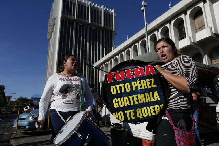 "Protesters play drums outside the court where Guatemala's former President Otto Perez Molina is expected to arrive to face corruption charges, following his overnight resignation in Guatemala City, Thursday, Sept. 3, 2015. The sign reads in Spanish ""Get out Otto Perez, Guatemala doesn't want you."" The president submitted his resignation at midnight local time late Wednesday after a judge issued an order to detain him in a corruption scandal. Perez Molina was already under order not to leave the country, and on Tuesday the congress lifted his immunity from prosecution. (AP Photo/Moises Castillo)"
