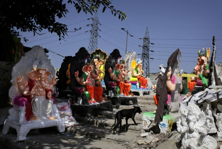 Idols of elephant headed Hindu god Ganesha are lined up for final touches in New Delhi, India, Wednesday, Sept. 9, 2015. The idols are in demand ahead of the Ganesh Chaturthi festival that celebrates the birthday of Lord Ganesha. (AP Photo/Altaf Qadri)