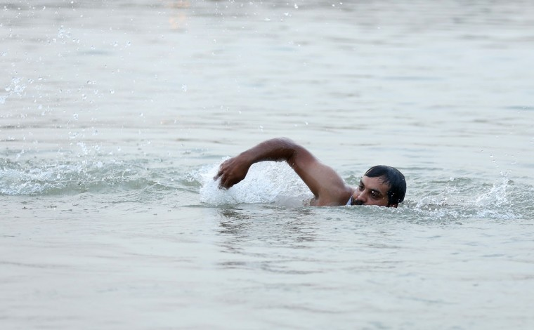 In this Wednesday, Sept. 9, 2015 photo, Mustafa Jassim Mohammed, 29, practices paddling with an arm maimed in a bombing as he swims in the Tigris River in preparation to face the danger of crossing the Mediterranean Sea, in the Azamiyah neighborhood in Baghdad, Iraq. He knows that migrants -- men, women and children -- have died when their smuggler boats capsized, and he's seen the heart-wrenching pictures of the drowned Syrian boy who washed ashore in Turkey last week. But he's also seen the TV footage of hundreds of migrants making their way across Europe and being welcomed in certain quarters. After more than a decade of chaos and war, it's a gamble he's willing to take. (AP Photo/Hadi Mizban)