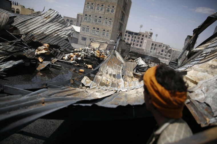 A worker looks at a chocolate factory destroyed by a Saudi-led airstrike in Sanaa, Yemen, Thursday, Sept. 17, 2015. Elsewhere, the Saudi-led coalition is pounding Yemen's Shiite rebels on the outskirts of the city of Marib in its push to retake the capital, Sanaa. (AP Photo/Hani Mohammed)