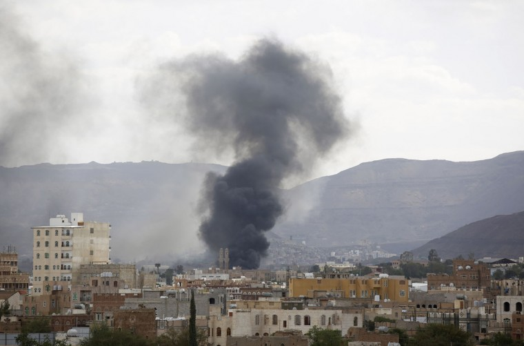Smoke rises after an airstrike by the Saudi-led coalition on an army base in Sanaa, Yemen, Thursday, Sept. 10, 2015. The impoverished country is torn between the Yemeni Shiite rebels, known as the Houthis, allied with army units loyal to former President Ali Abdullah Saleh, and forces loyal to exiled President Abed Rabbo Mansour Hadi, who fled to Saudi Arabia in March. (AP Photo/Hani Mohammed)